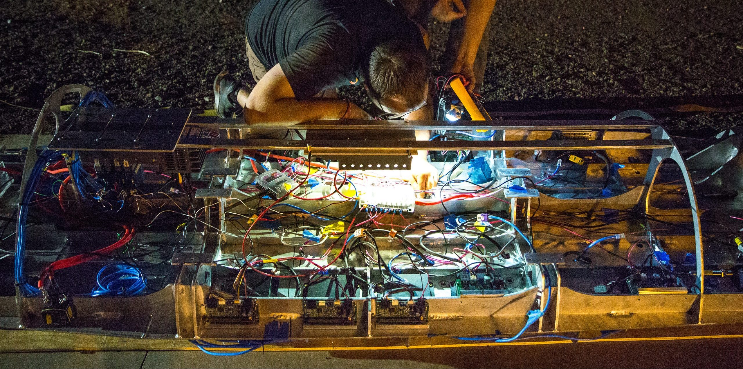 A pair of students collaborating on the AZ hyperloop